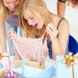 Royalty-Free Stock Photo: Young girl opening birthday present