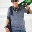 Royalty-Free Stock Photo: Young male holding skateboard