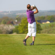 Golf Swing by a young man - Stock Photo