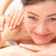 Royalty-Free Stock Photo: Smiling senior woman at massage spa