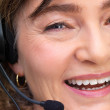 Woman talking on a headset - Stock Photo
