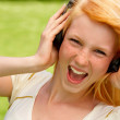 Young Teenage Girl Singing along - Stock Photo