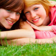 Two young teens relaxing in a park. - Stock Photo
