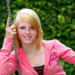 Young teenager on a swing - Stock Photo