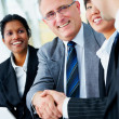 Handshake and teamwork - Stock Photo