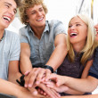 Hands of young guys and girls showing unity - Stock Photo