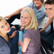 Royalty-Free Stock Photo: Young guys and girls sitting on floor