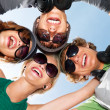 Young guys and girls in sunglasses - Stock Photo
