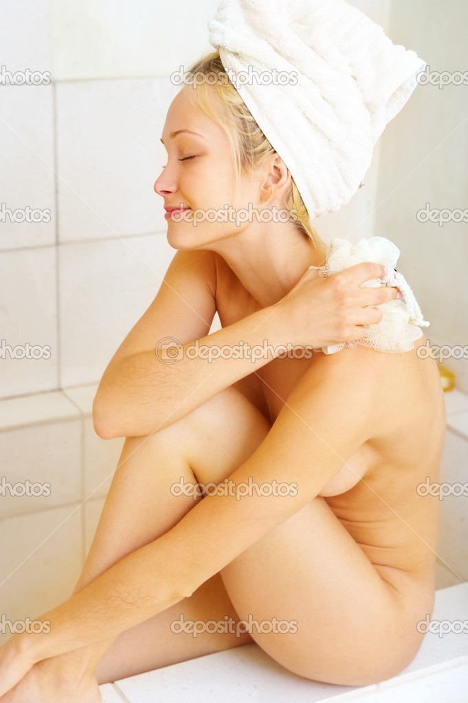 A beautiful young lady pampering herself — Stock Photo #3240442