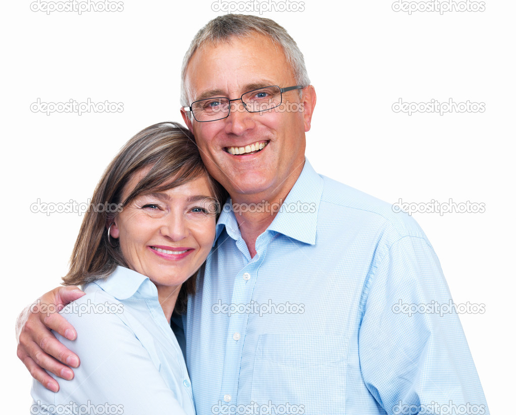 Closeup of a happy senior couple looking at camera against white background  Stock Photo #3240736