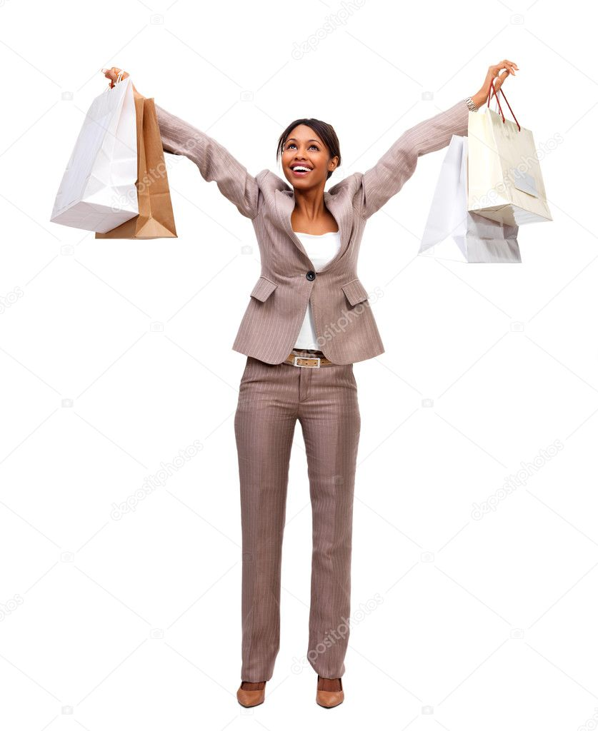 Portrait of a laughing businesswoman holding shopping bags. The joy and happiness of women shopping. Isolated on white background — Stock Photo #3242221