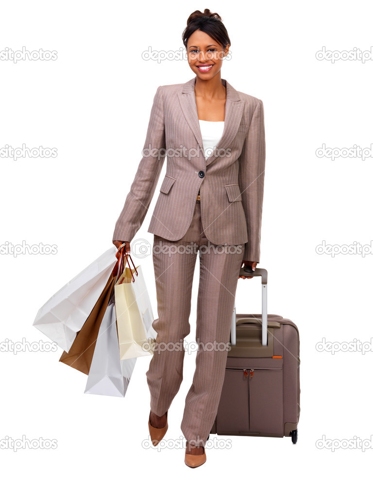 Beautiful young businesswoman with luggage and shopping bags. Ready to go on a business travel. Isolated on white — Stock Photo #3242244