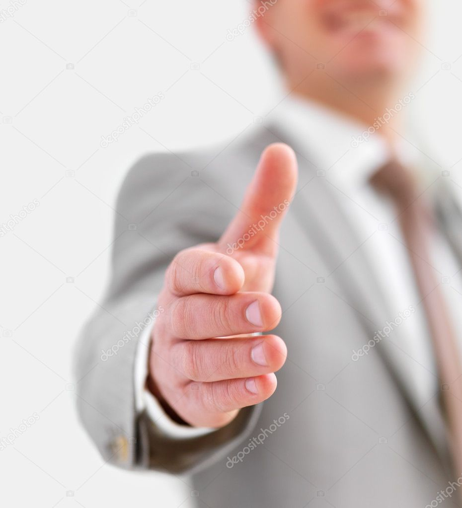 Close-up portrait of a successful business man smiling, gesturing a hand shake — Stock Photo #3242614