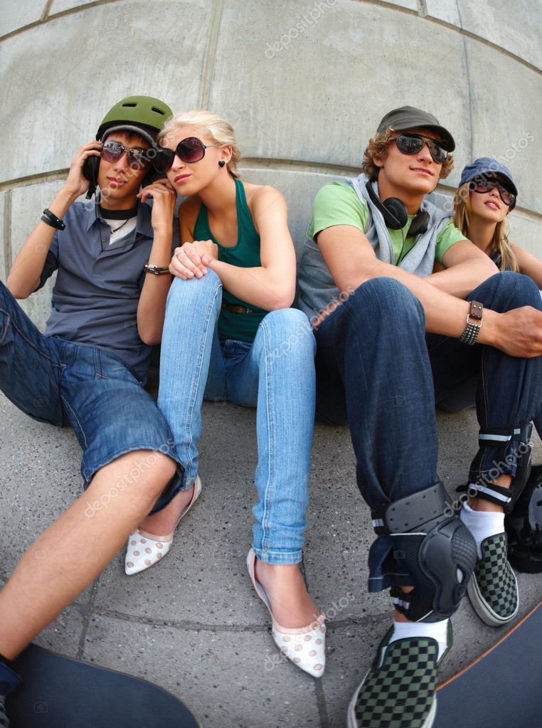 Group of young friends sitting side by side — Stock Photo #3243420