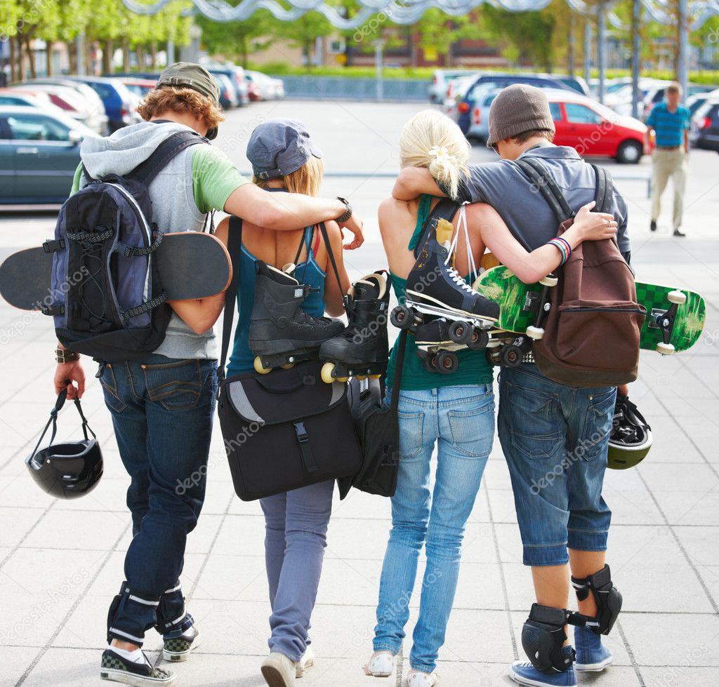 Rear view of young couples walking on street — Stock Photo #3243482