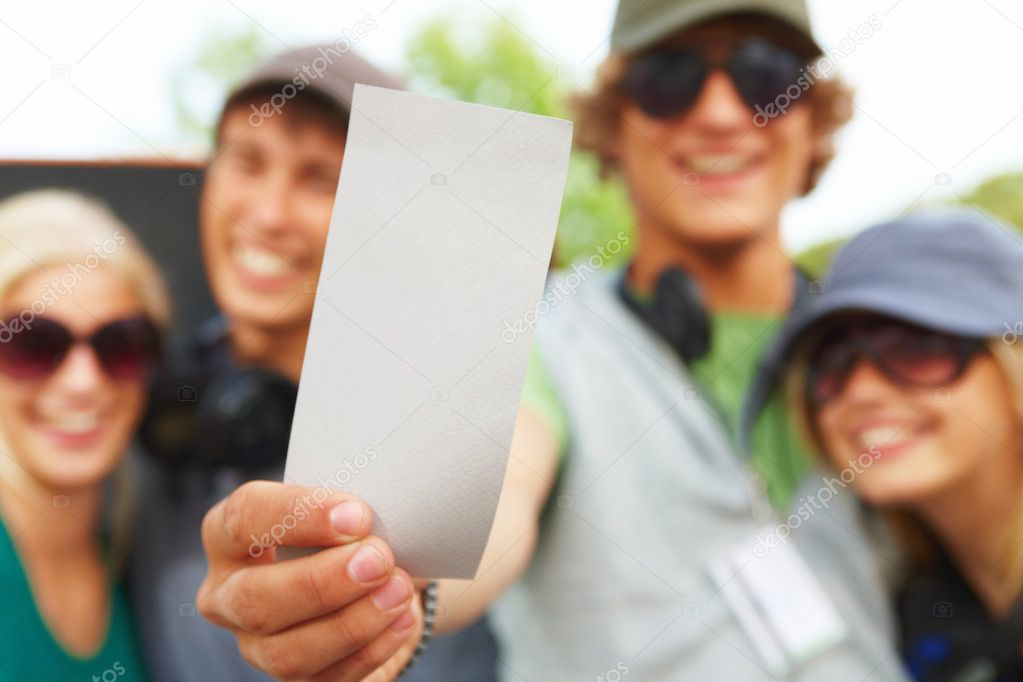 Group of happy young friends holding blank card or ticket. You won! — Stock Photo #3243602