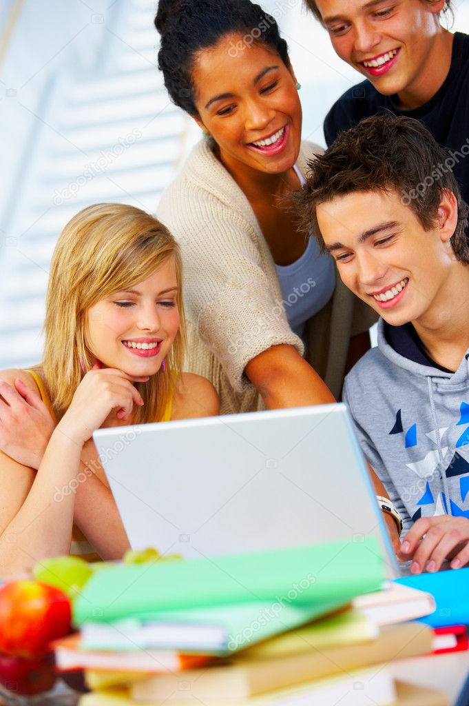 This is a portrait of a study group at work with a laptop. — Stock Photo #3244115