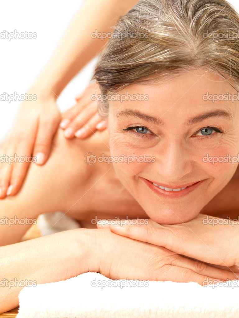Close-up of a mature woman receiving shoulder massage
