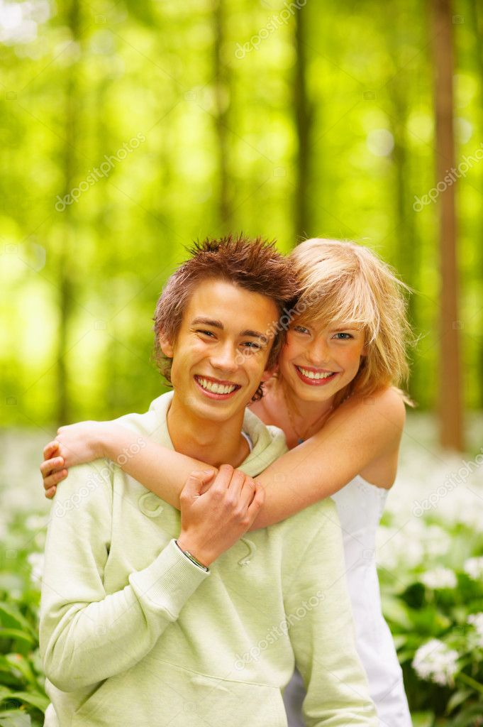 A portrait of a sweet couple in love. Outdoors enjoying the spring and each others company. This collections unique keyword is: younglove123  Stock Photo #3245658