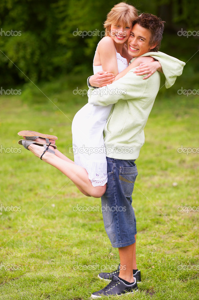 A portrait of a sweet couple in love. Outdoors enjoying the spring and each others company.  — Stock Photo #3245675