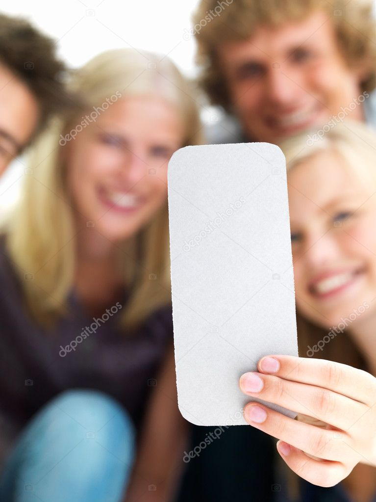 Closeup of young boys and girls holding out a  blank card — Stock Photo #3246510