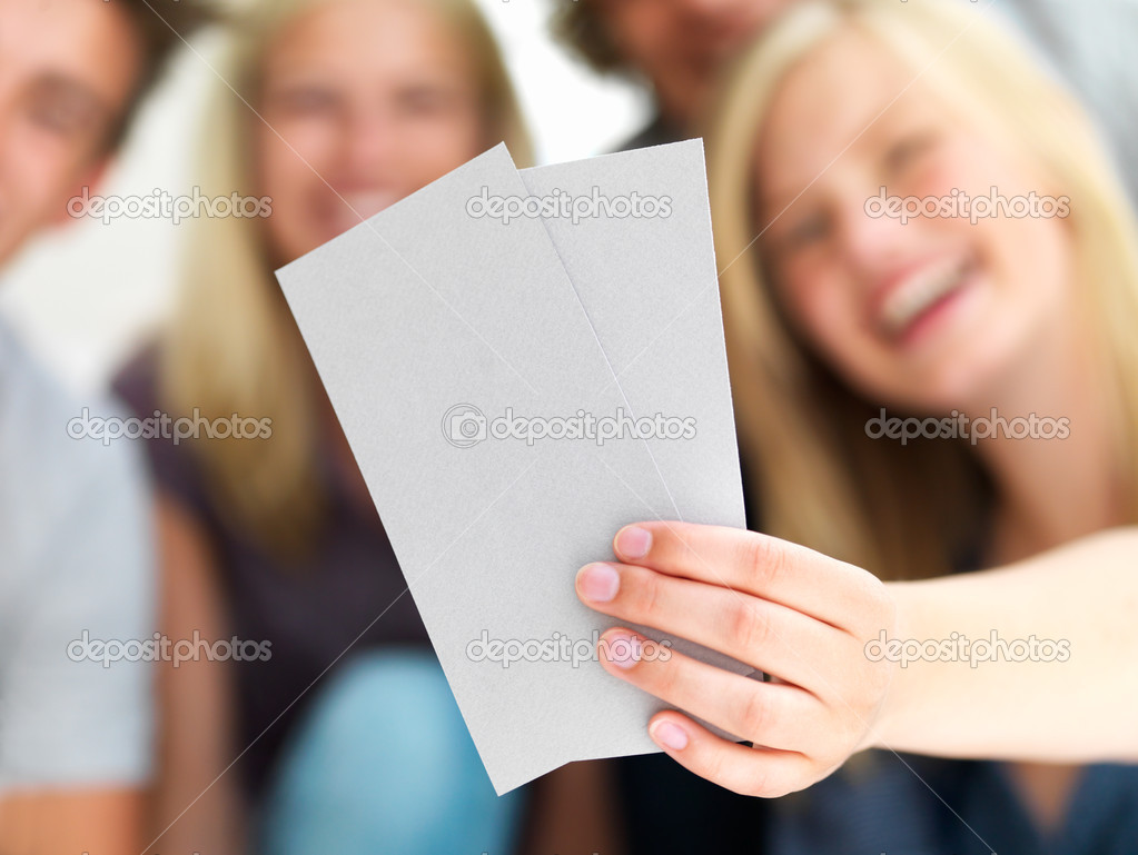 Young guys and girls looking at blank card and holding  Foto Stock #3246515