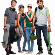 Young boys and girls standing with skateboard and helmet - Stock Photo
