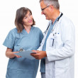 Happy senior doctors with reports - Stock Photo