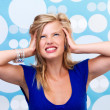 Young woman irritated - Stockfoto