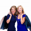 Portrait of happy young friends with shopping bags - Stock fotografie