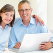 Royalty-Free Stock Photo: Happy old couple using laptop