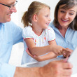 Royalty-Free Stock Photo: Grandparents and granddaughter using laptop