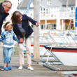 Happy grandparents with their granddaughter at dock - Stock Photo
