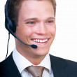 Royalty-Free Stock Photo: Smiling young businessman with headset isolated  white backgroun