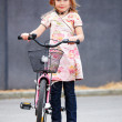 Royalty-Free Stock Photo: Child standing with bicycle with helmet on head