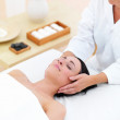 Beautiful young lady receiving facial massage at day spa - Foto de Stock