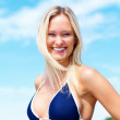 Portrait of a happy woman in blue bikini bra - Stock Photo