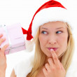 Closeup of a pretty woman wearing Santa's hat and holding a gift - Foto Stock