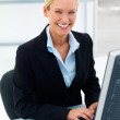 Royalty-Free Stock Photo: Happy business woman working on a computer at office