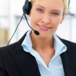 Portrait of a business woman wearing headset - Stock Photo