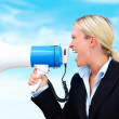 Royalty-Free Stock Photo: Business woman shouting through megaphone