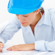 Royalty-Free Stock Photo: Closeup of a young female architect marking blueprints isolated