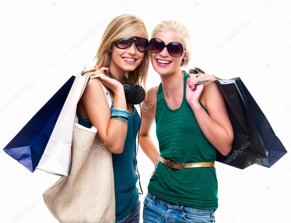 Portrait of happy young girls standing together with shopping bags — Stock Photo #3267791