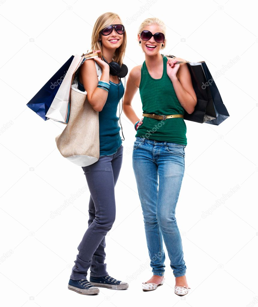 Full length of happy young friends standing with shopping bags against white background — Stock Photo #3267795