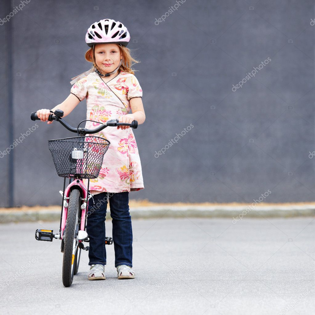 Baby standing with bicycle with helmet on head  Stock Photo #3268724