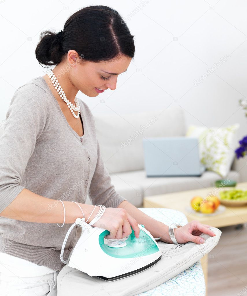 Portrait of a happy young lady ironing her clothes — Stock Photo #3268980