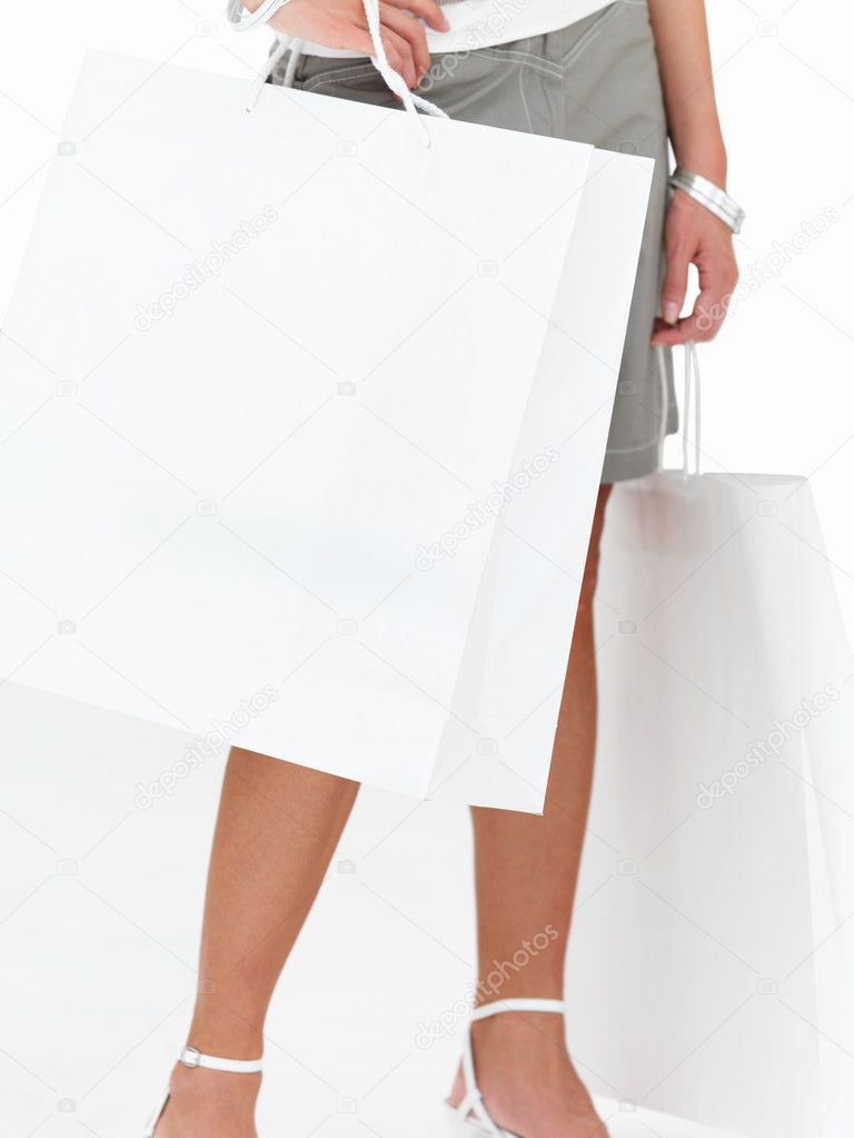 Closeup of a lady holding shopping bags against isolated white background — Stock Photo #3269123