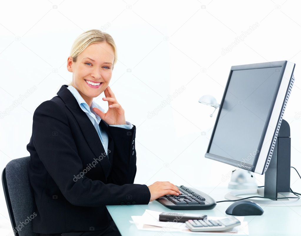 Portrait of a young happy business woman working on a computer isolated at white background  Stock Photo #3269362