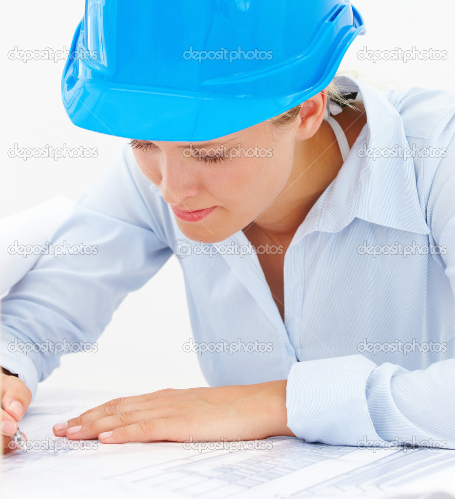 Closeup of a young female architect marking blueprints isolated on white background — Stock Photo #3269407