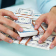 Closeup of a business man with hands over money - Stock Photo